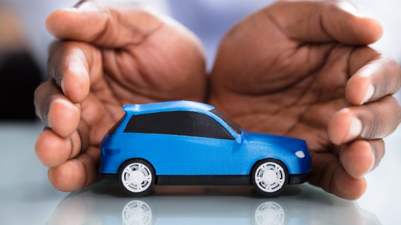 Auto Insurance Hand Protecting Toy Car