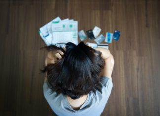 Woman Stressed About Credit Card Payment Bills