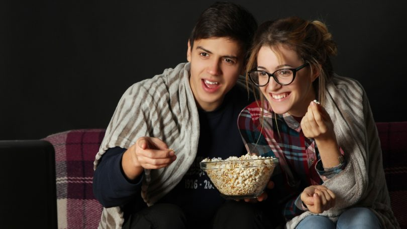 Young Couple Movie Night At Home Popcorn