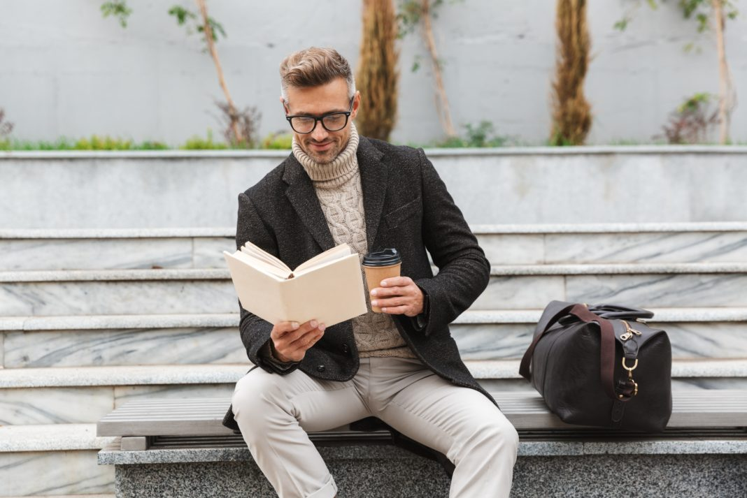 Man Wearing Blazer Jacket Reading Book With Coffee Outdoors