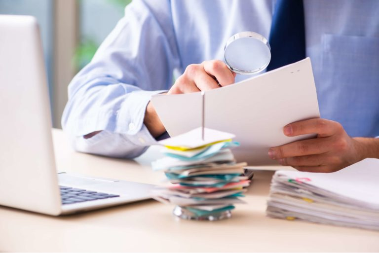 Man Looking Over Paper Budget Planning Reviewing