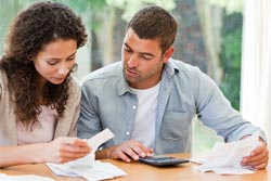 couple calculating finances