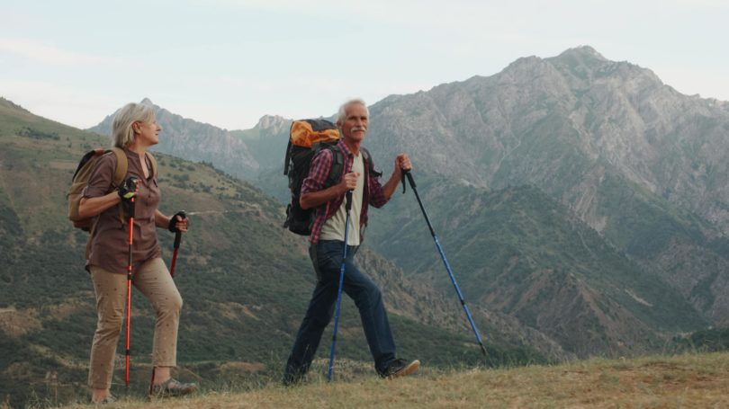 Active Elderly Couple Hiking Mountain