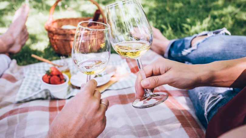 Couple In Love On A Picnic White Wine Strawberries