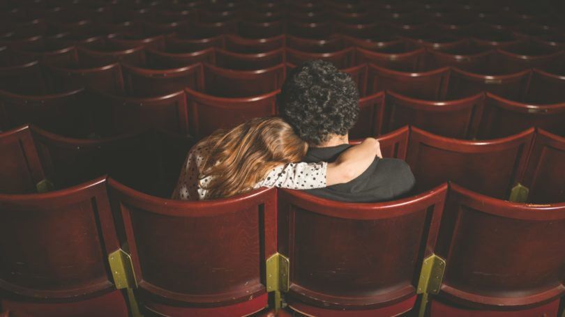 Couple In Movie Theater Watching Movie