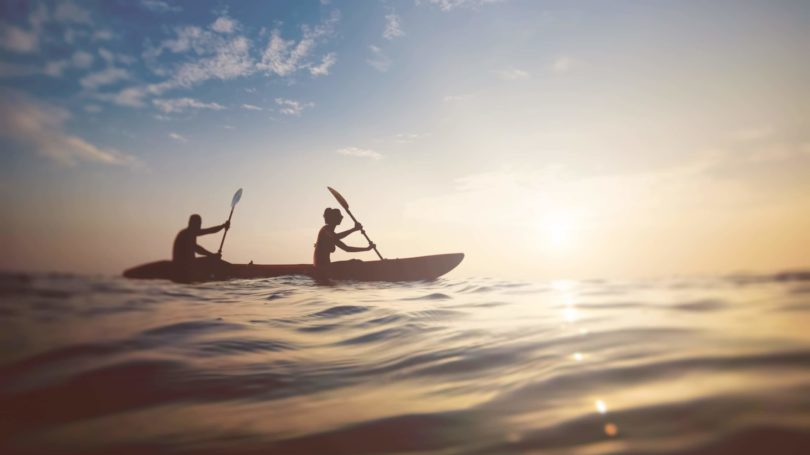 Couple Kayaking Boat Ocean Horizon