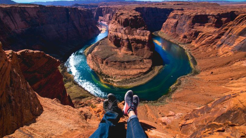 Couple Sitting On Top Of Grand Canyon Shoefie