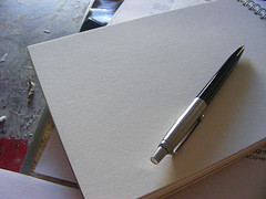 Pen and pad of paper