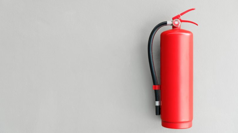 Fire Extinguisher On Wall Red