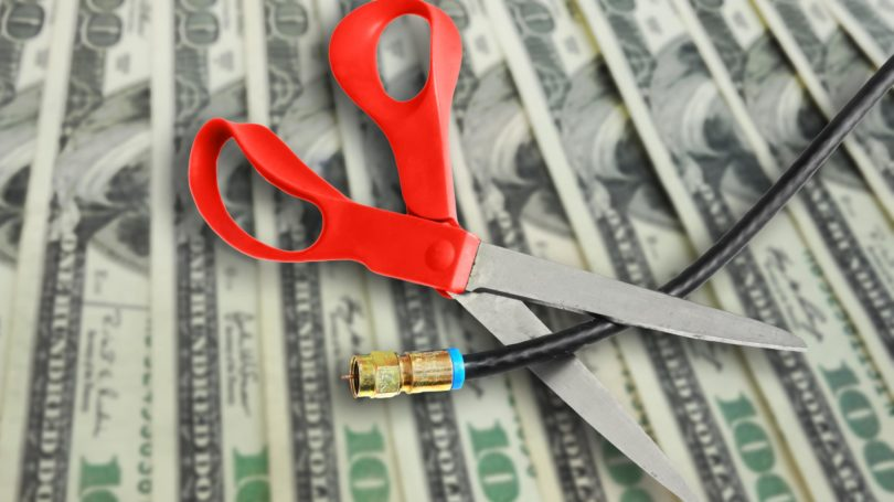 Scissors Cutting Coax Cable On Cash Expensive
