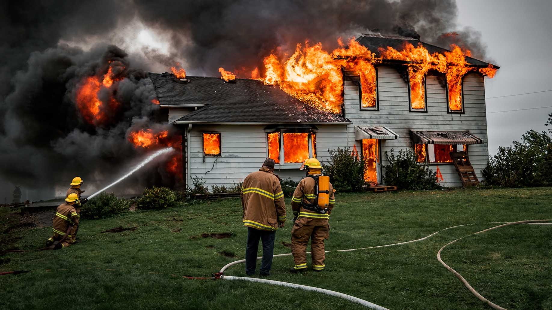 Fire Fighters Putting Out House