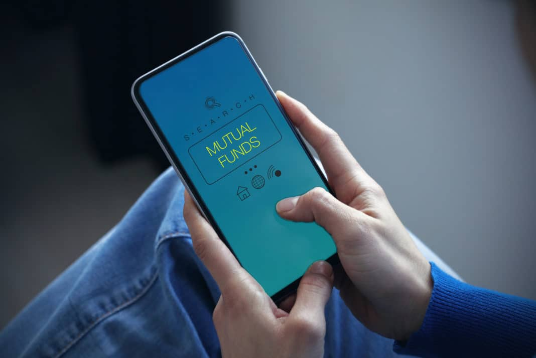 Person Holding Mobile Phone Displaying Mutual Funds