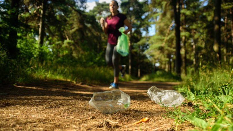 Plogging Running While Picking Up Plastic Outdoors