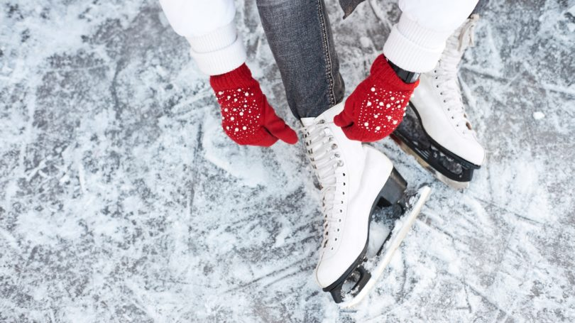 Woman Sitting In Rink To Tie Her Ice Skates Skating Gloves