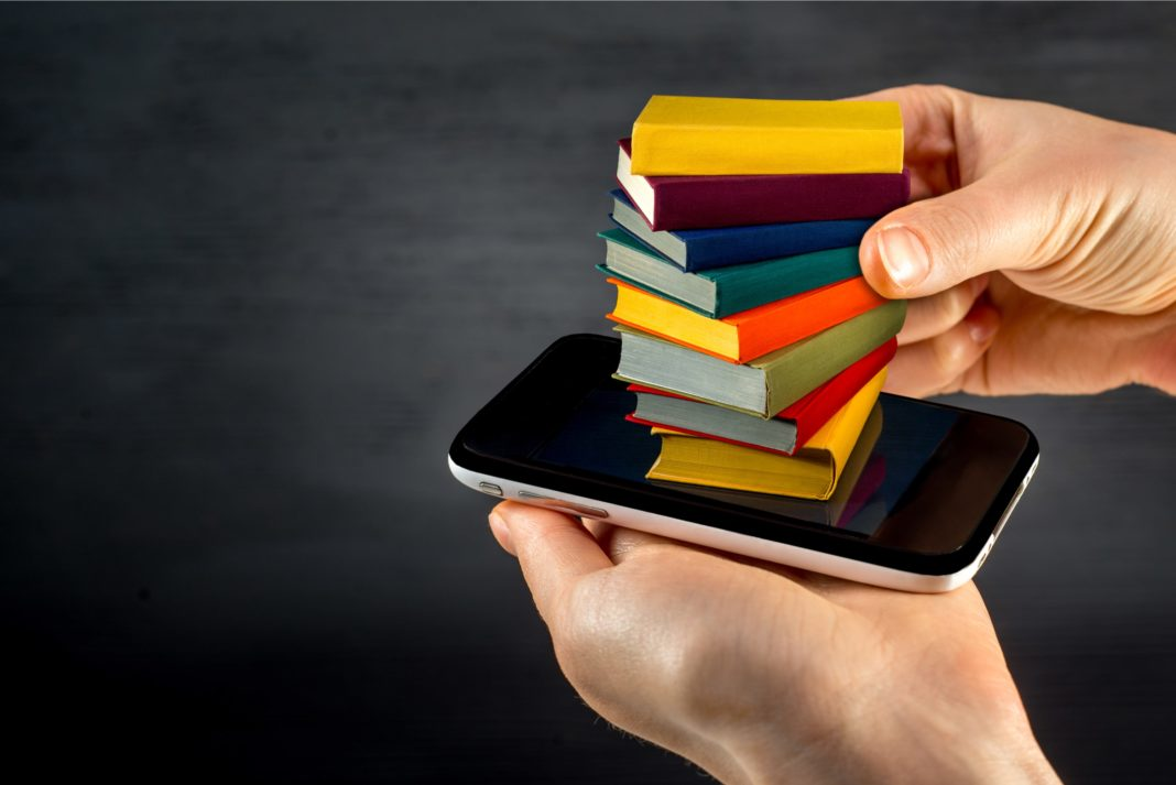 Colorful Books Stacked On Phone Downloadable Ebook Concept