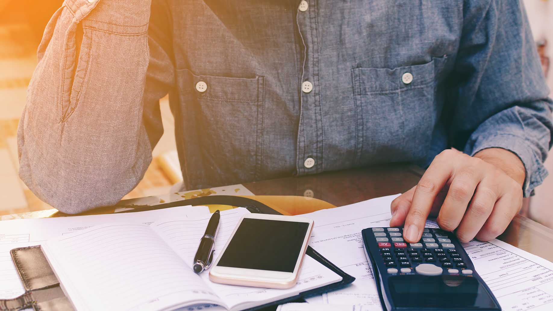 man counting using calculator stress problem