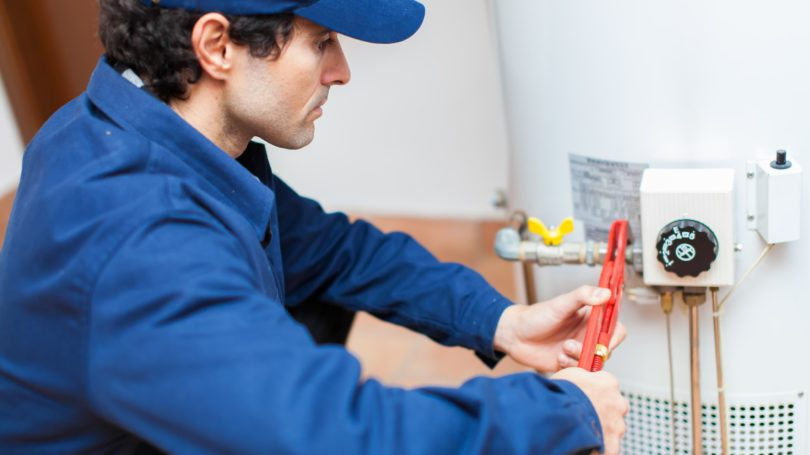 Plumber Fixing Hot Water Heater Tools Maintenace