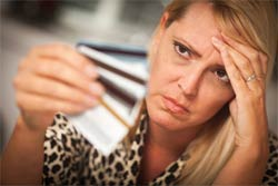 upset woman credit cards