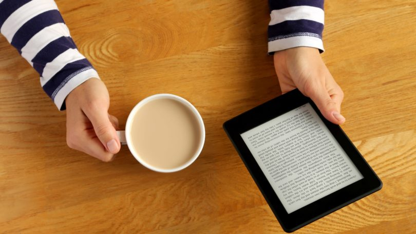 Woman Reading Ebook On Tablet Kindle With Latte