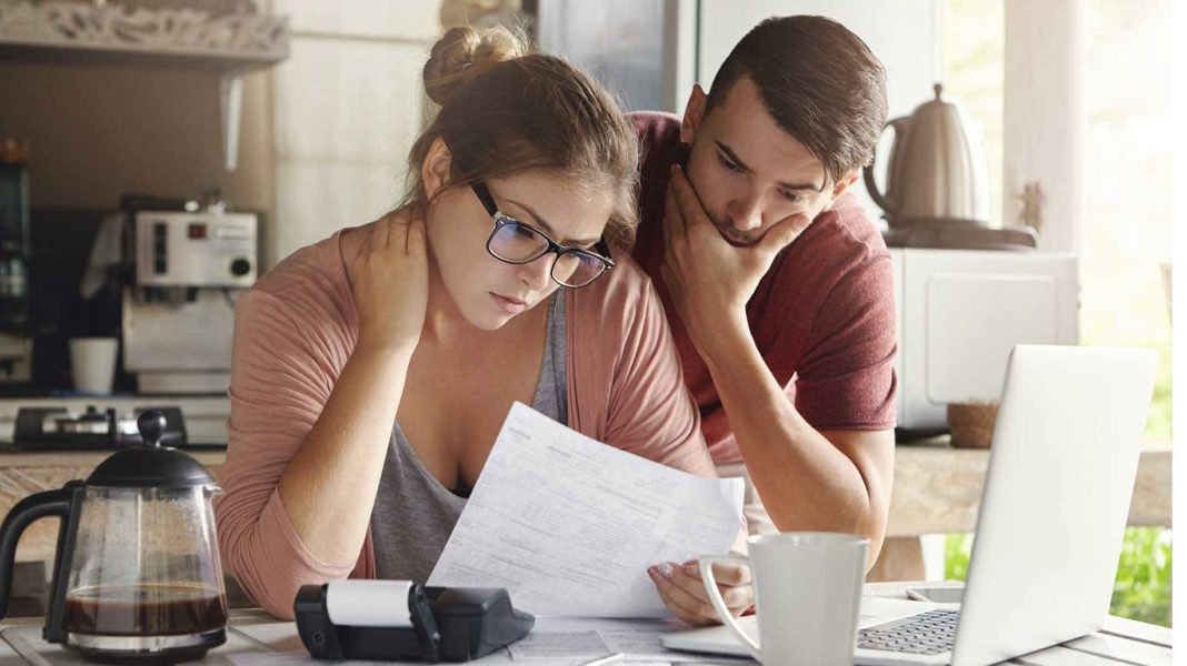 young caucasian family having debt problems?