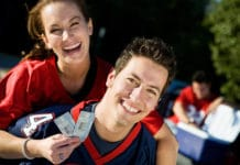 Couple Holding Sports Tickets