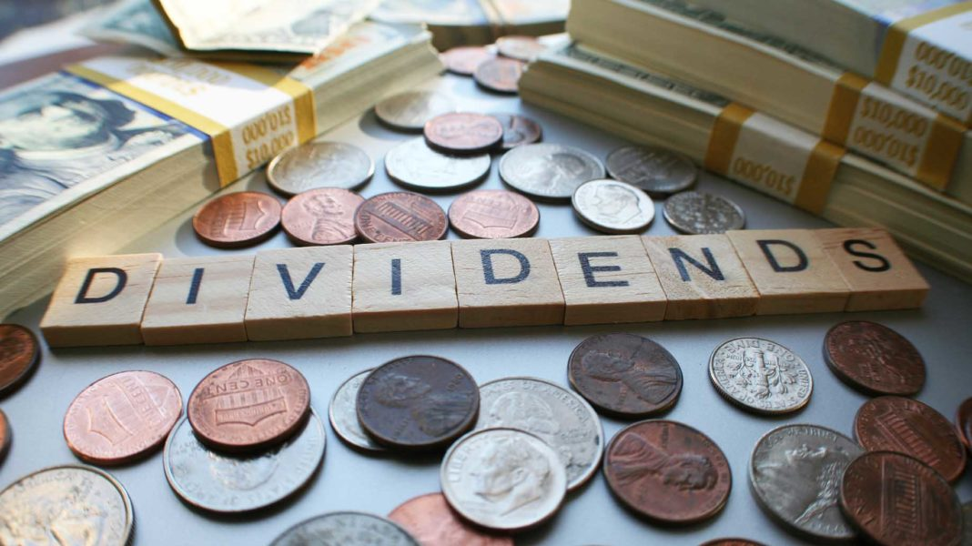 dividends stock market in table with coins