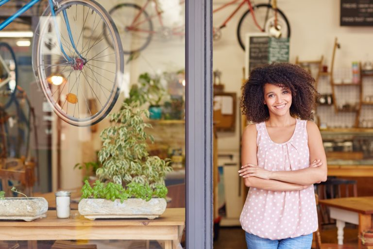 Young Woman Business Owner Standing In Front Of Her Store Small