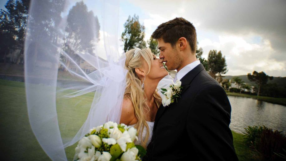 16 cheap budget wedding venue ideas for the ceremony reception married couple at wedding venue junglespirit Gallery