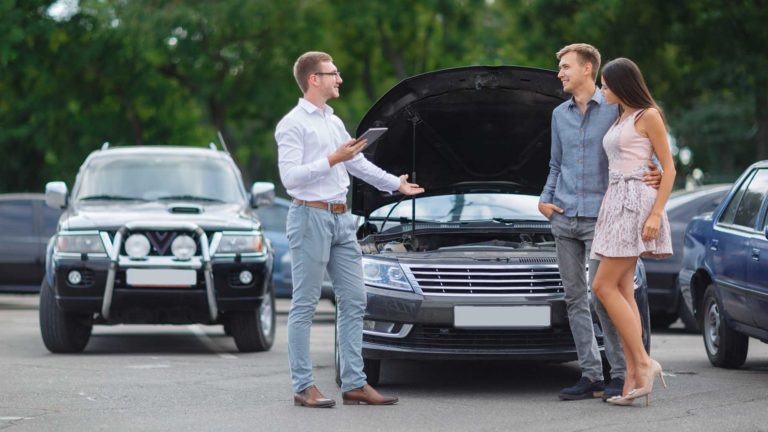 young couple buying used car