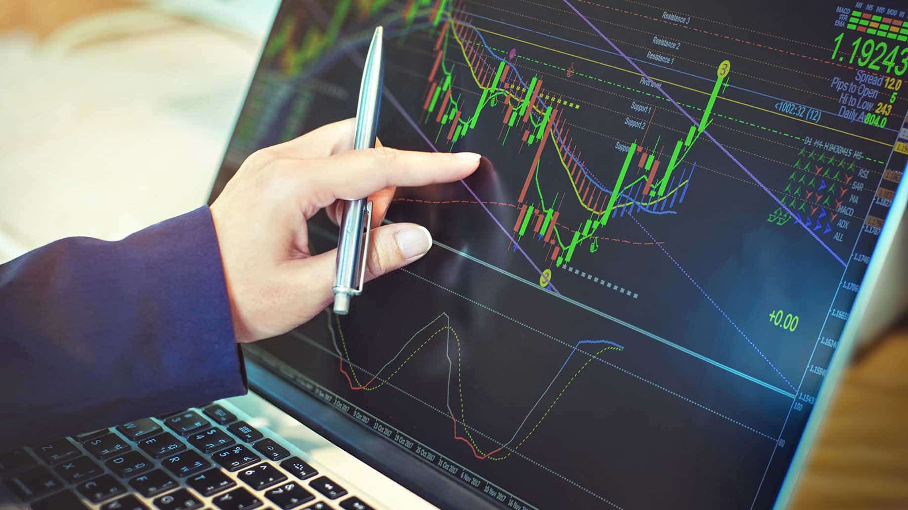businessman working with stock trading on laptop