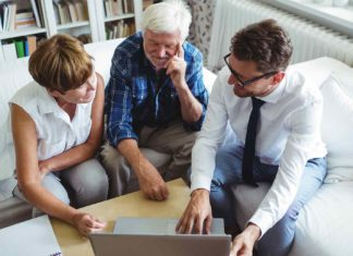 couple planning their investments with financial advisor