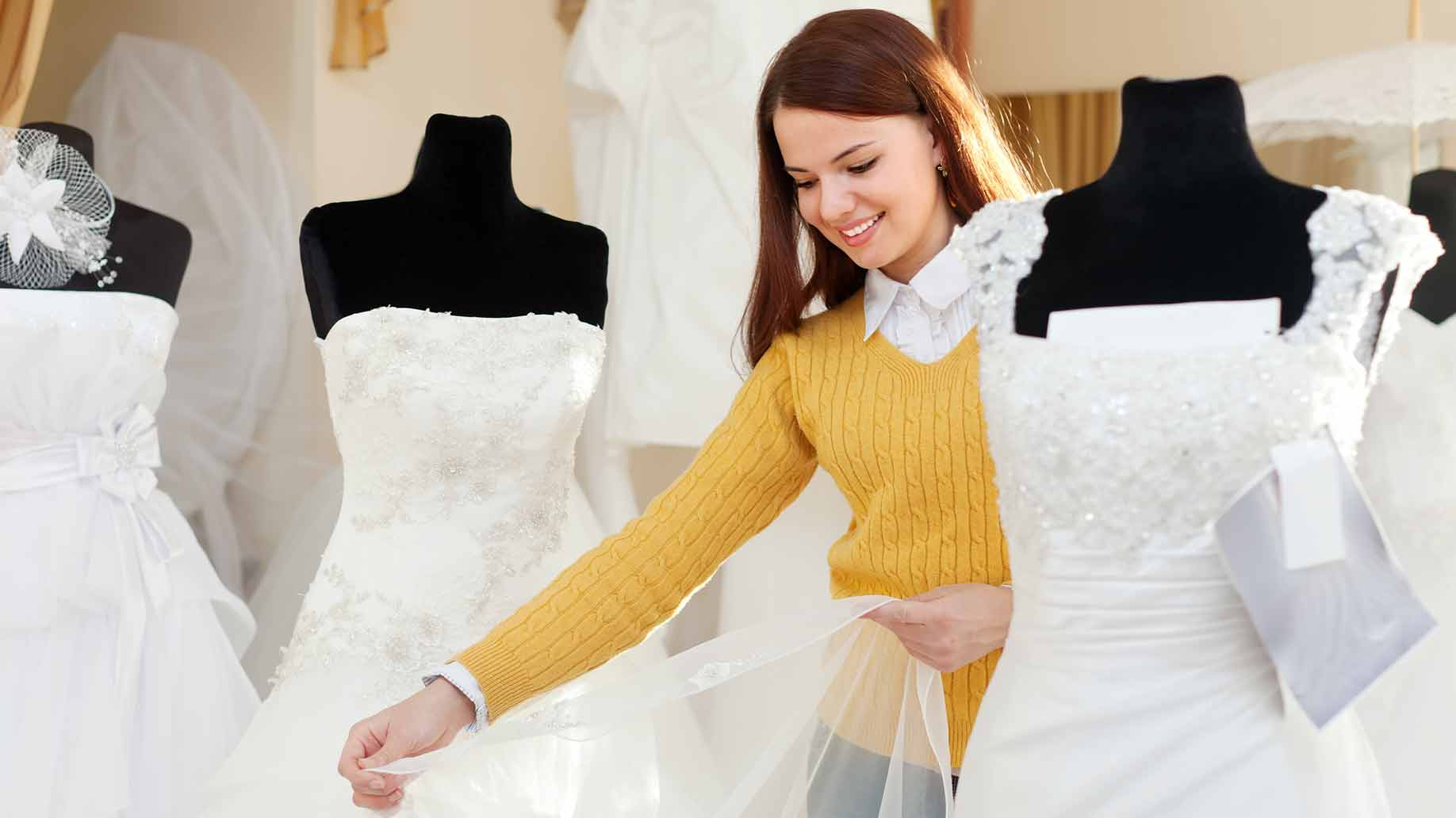 woman shopping for a bridal gown