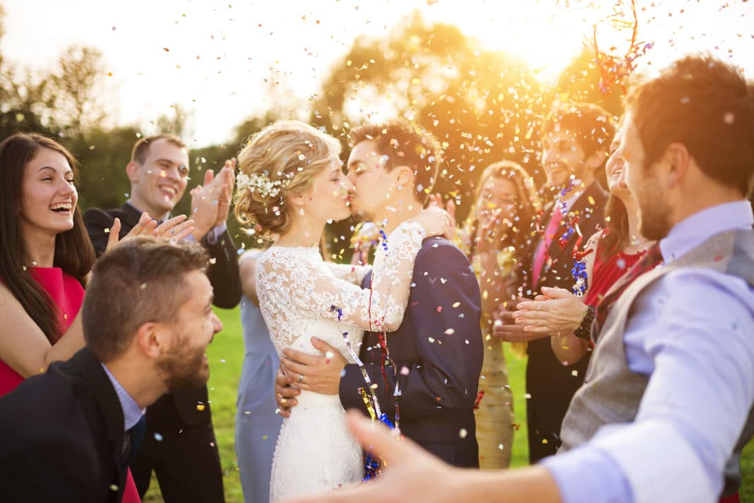 Married Couple Kissing Wedding Ceremony