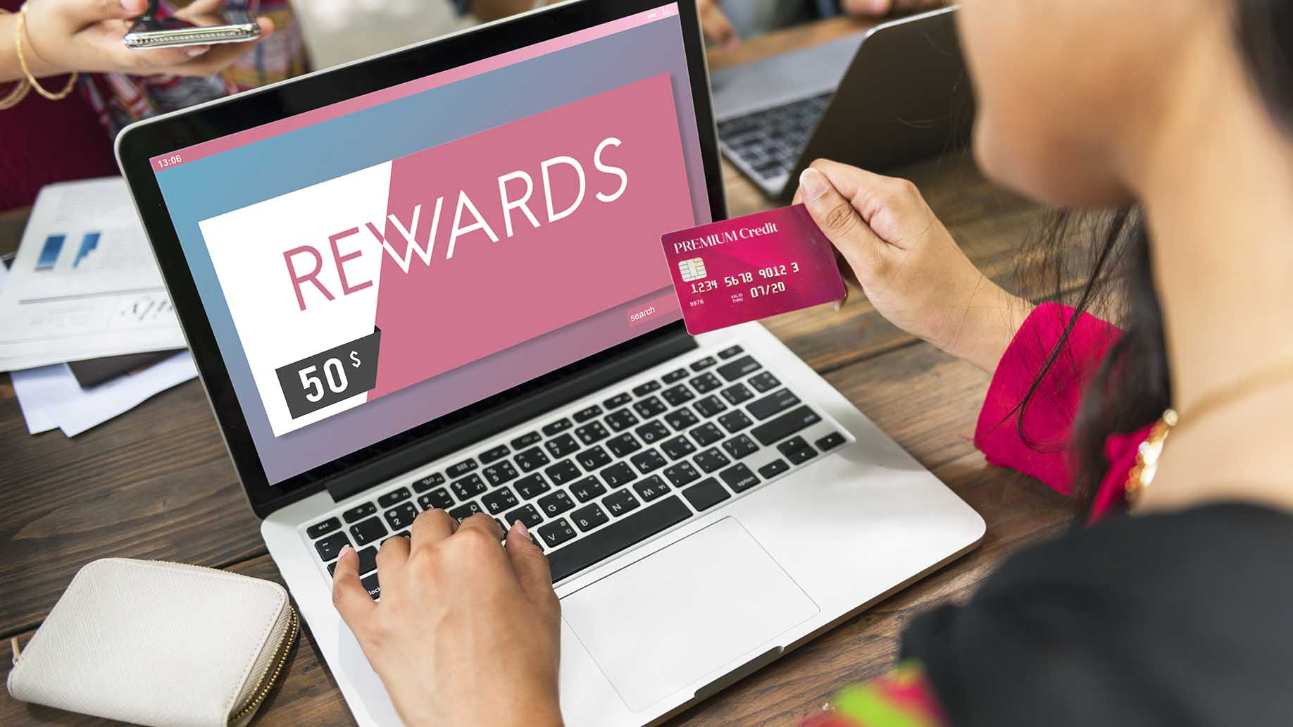 woman holding credit card for rewards