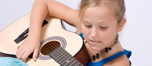 girl learning guitar
