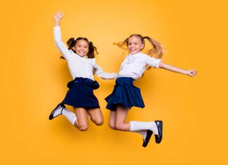 Girls Jumping In Their School Uniforms