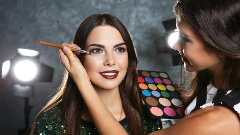 Makeup Artist Applying With Brush On Client