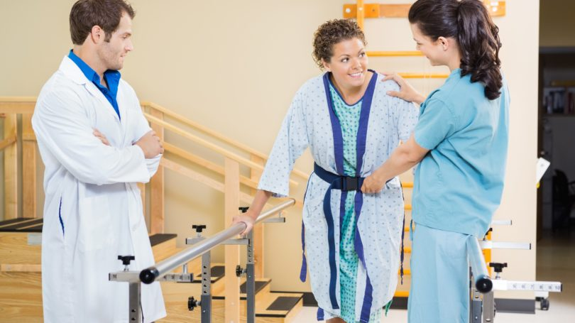 Physical Therapy Assistant Woman Client Walking Crutch