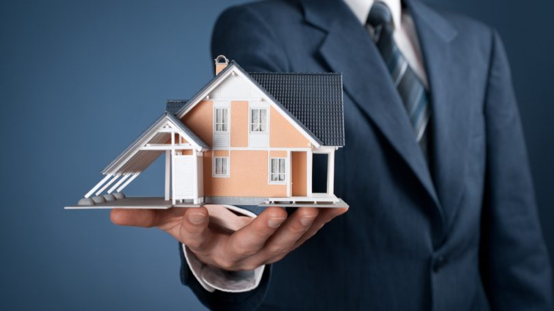 Real Estate Agent Broker Holding House Home