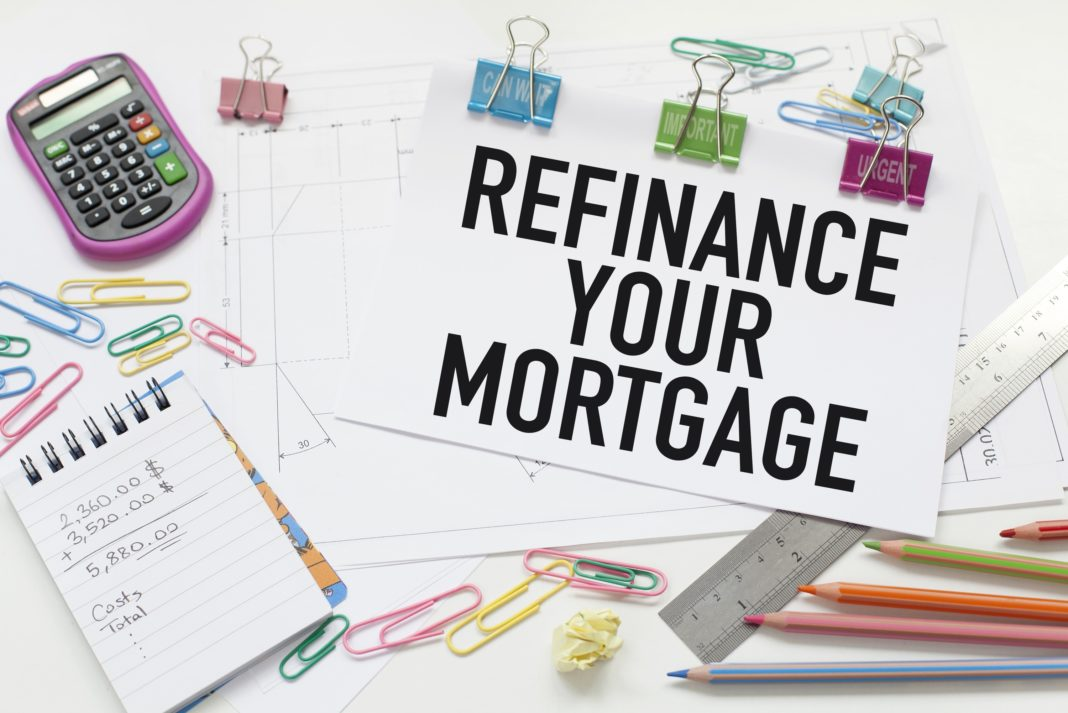 Refinance Your Mortgage Notebook Calculator Office Desk