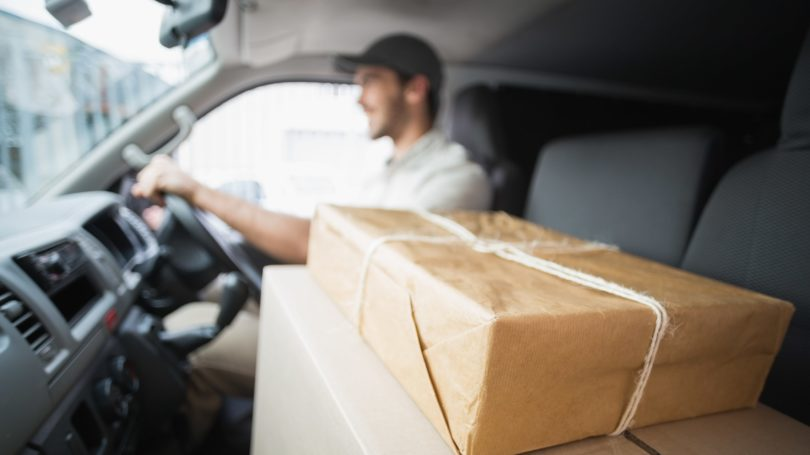 Delivery Driver Driving Parcels Packages In Van