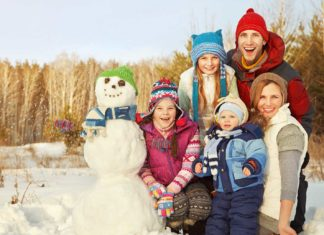 portrait cheerful family snowman happy children