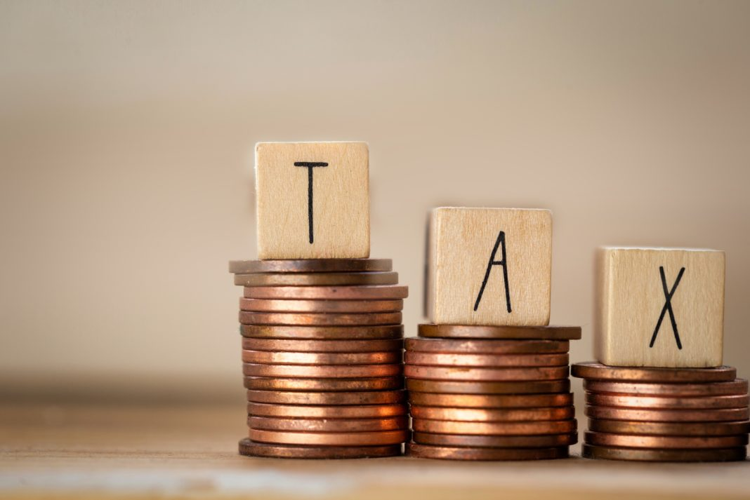 Tax Coins Pennies Stacked Block Letters