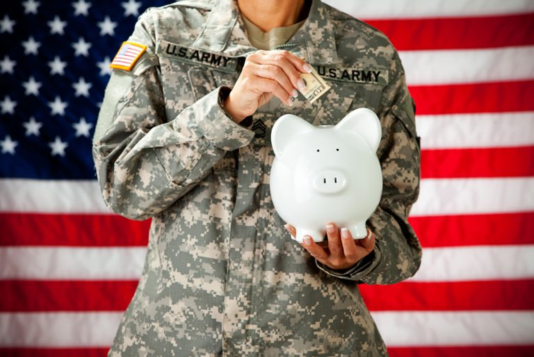 Soldier Putting Money In Bank Saving Investing American Flag