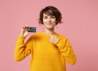 Young Woman Student Pointing To Credit Card Loan