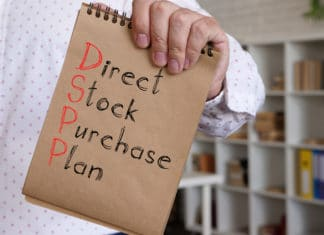 Man Holding Notebook With Direct Stock Purchase Plan Text