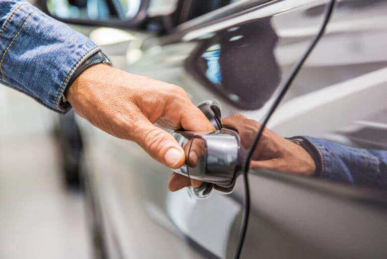 Mans Hand Opening Gray Car Door