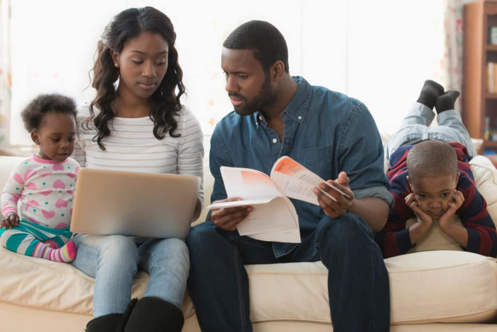 Stressed Parents Paying Bills On Laptop