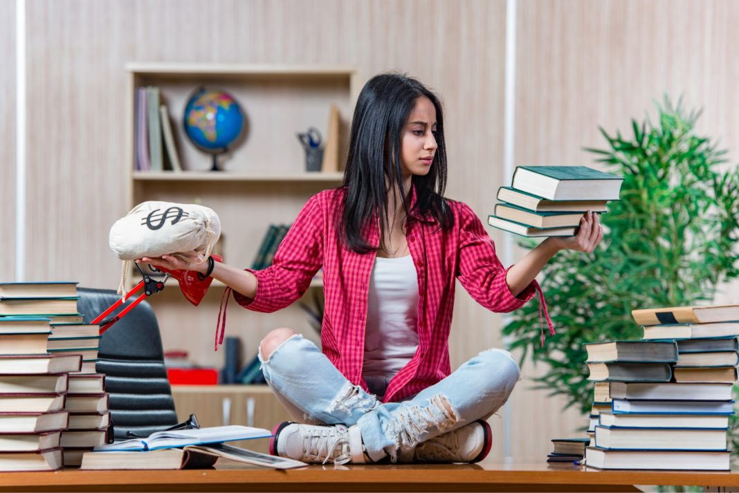 Female Student Prepping For College Loans Finances