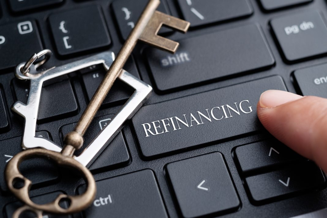 Finger Clicking On Refinancing Keyboard House Mortgage Key